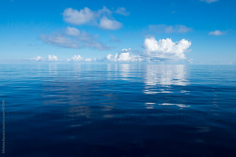 Calm blue sea in the morning by michela ravasio for Stocksy United
