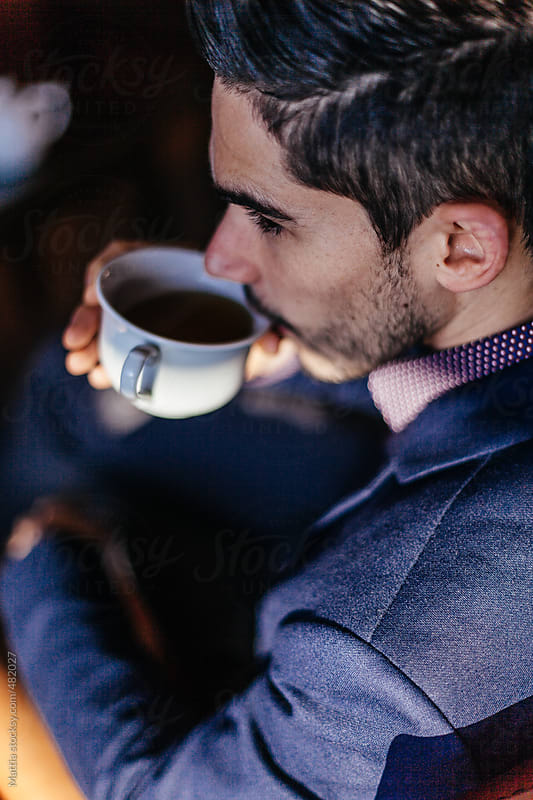 Young Businessman Drinking Coffee by HEX. for Stocksy United
