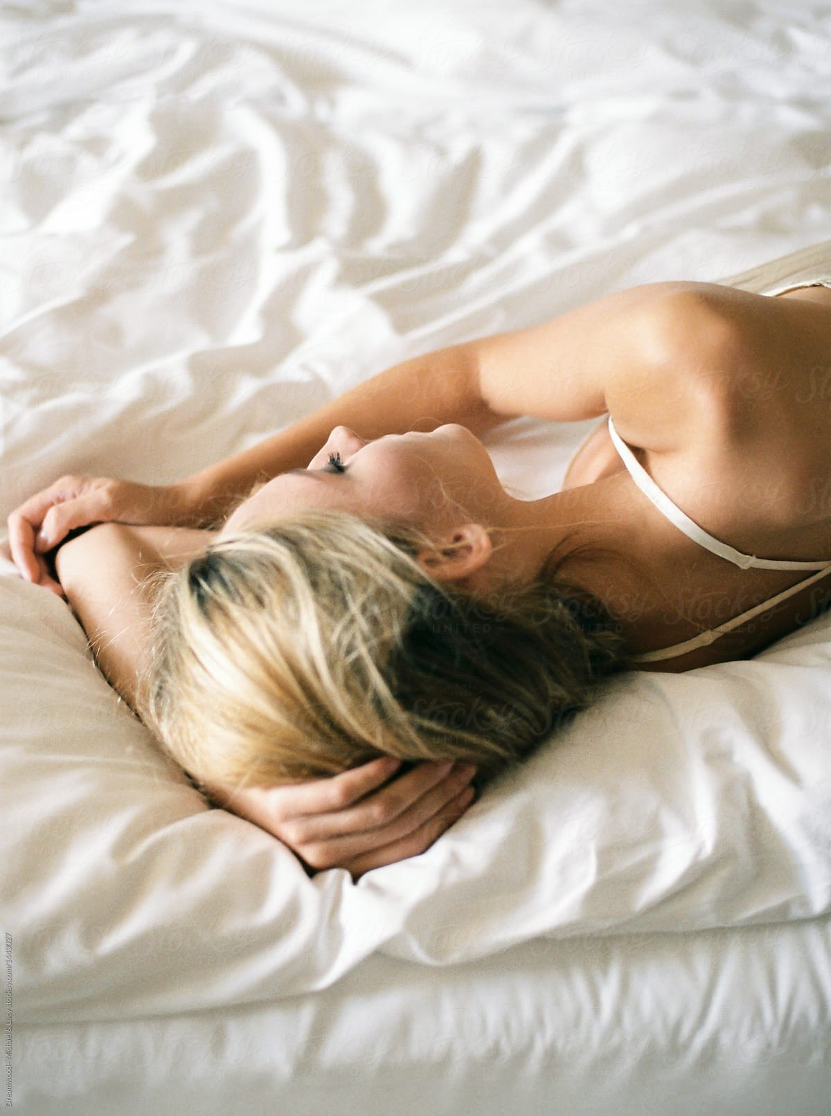 Lovely girl lying on bed by Dreamwood Photography - Morning ...