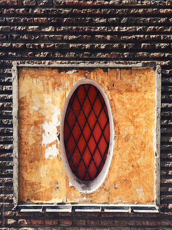 Circular shape window by German Parga for Stocksy United