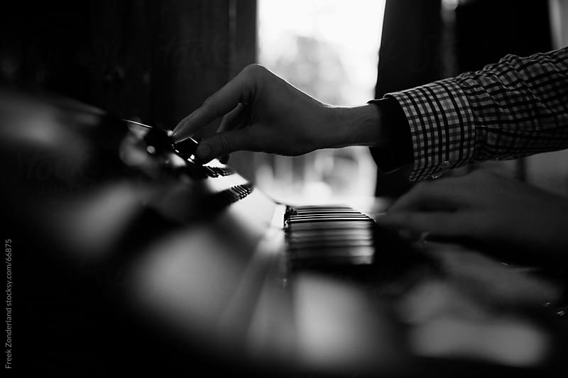 Close-up of a hand playing on a synthesizer by Freek Zonderland for Stocksy United