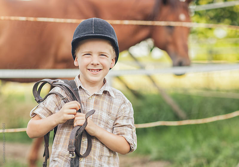 Boy With Riding Equipment by Lumina for Stocksy United
