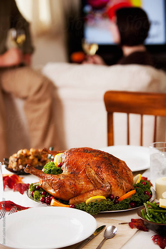 Thanksgiving: Turkey With People Behind by Sean Locke for Stocksy United
