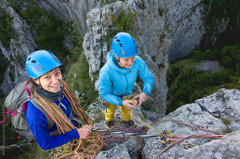 Team of two female climbers on a rocky ridge by RG&B Images for Stocksy United