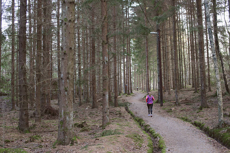 Women running on a path in the woods. by Jonas Räfling for Stocksy United