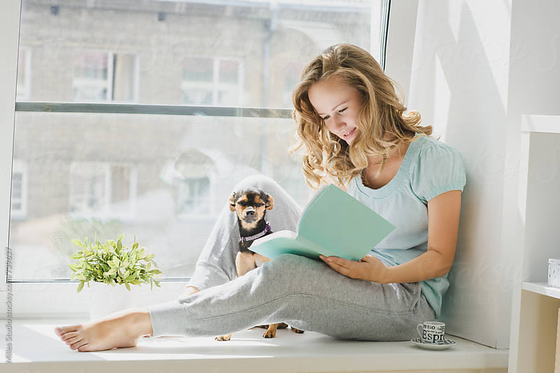 Woman reading at home by Milles Studio for Stocksy United