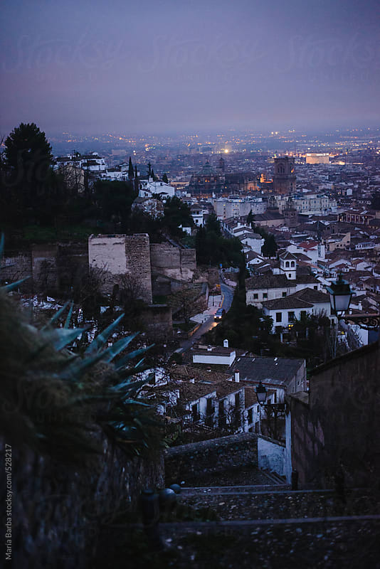 Cityscape from Albayzin's neighbourhood in Granada at twilight by María Barba for Stocksy United
