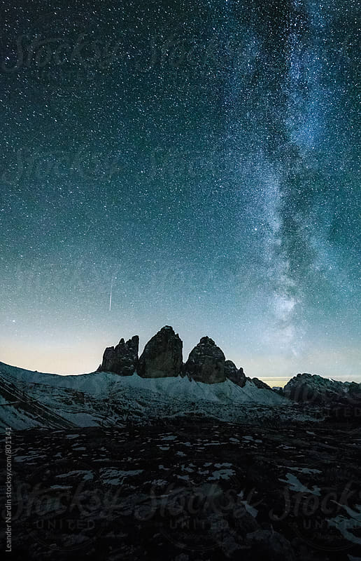 blue milky way above the famous three peaks in the italian alps in a clear night by Leander Nardin for Stocksy United