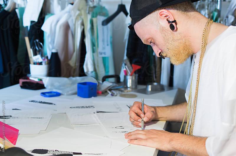 Man designs fashion by Alessio Bogani for Stocksy United