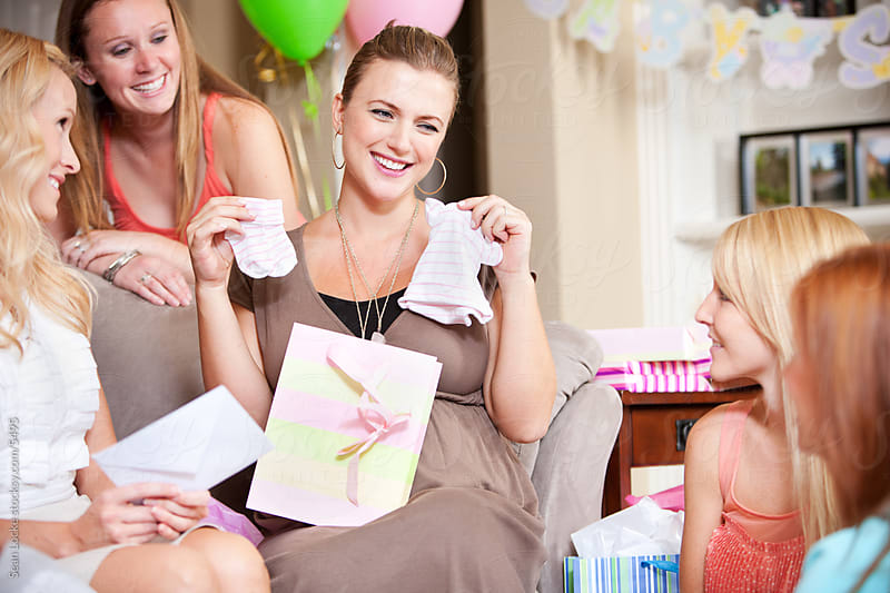 Baby Shower: Mom Gets Cute Baby Clothing Gifts by Sean Locke for Stocksy United