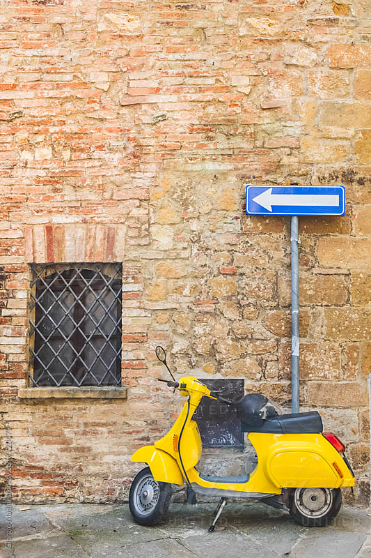 Yellow Italian Motorcycle in an Old Town by Giorgio Magini for Stocksy United