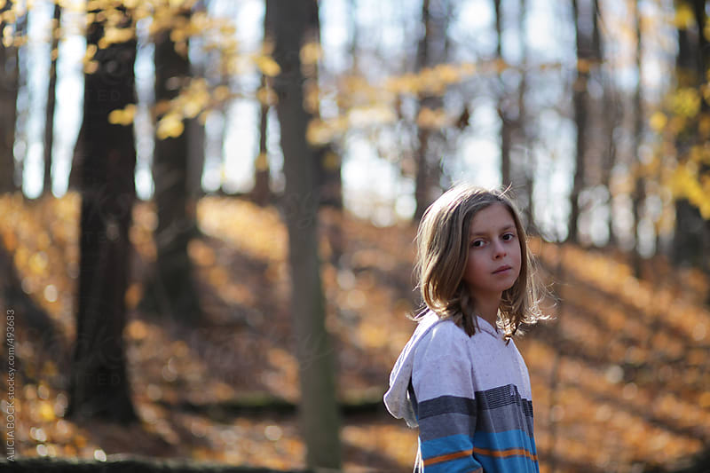 A Long Haired Boy During An Autumn Hike Through A Beautiful Forest by ALICIA BOCK for Stocksy United