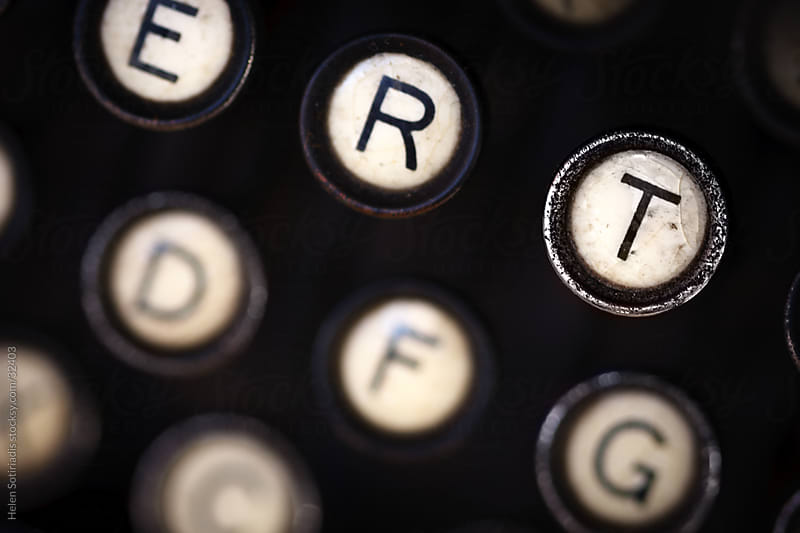 a close up of the keys of an old, antique, analog typewriter by Helen Sotiriadis for Stocksy United