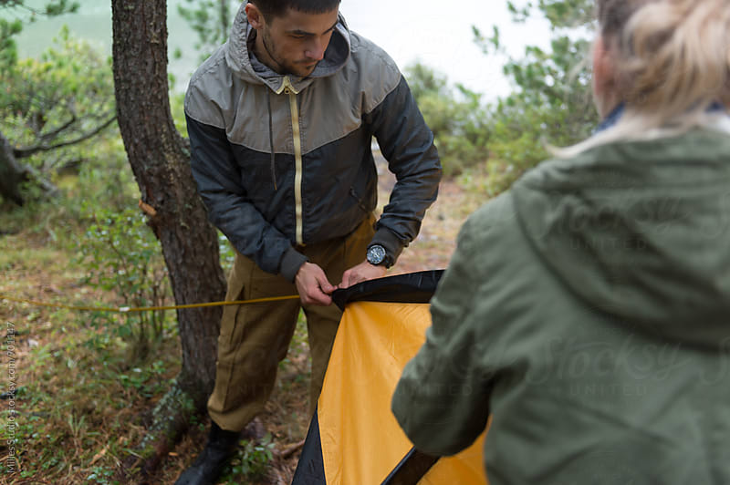 Couple pitching the tent by Milles Studio for Stocksy United