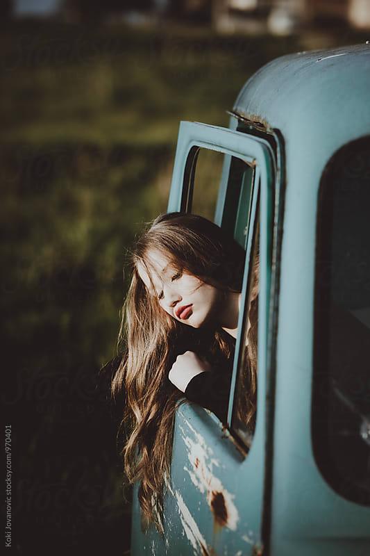 Girl in car by Koki Jovanovic for Stocksy United