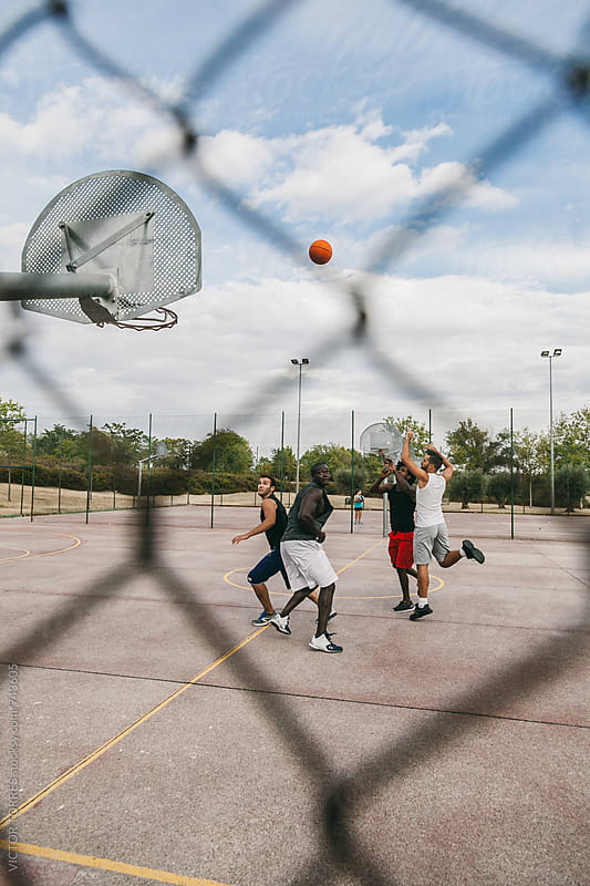 Friends Playing in a Street Basketball Court by Victor Torres for Stocksy United