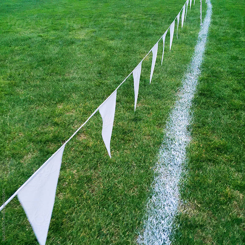 White Flags On a Cross Country Running Course by ALICIA BOCK for Stocksy United