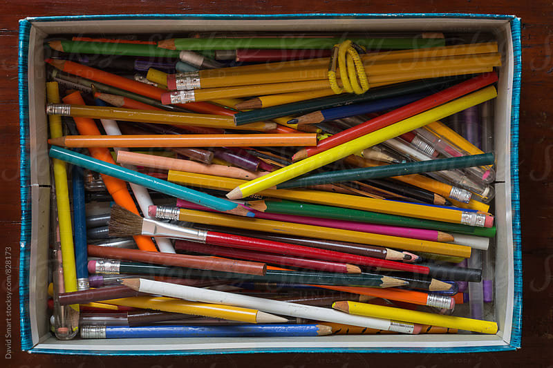 Discarded pens and pencils in a shoebox shot from above by David Smart for Stocksy United