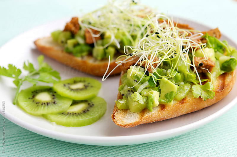 Baguettes with Avocado Kiwi Salsa and Spicy Tofu Pieces by Harald Walker for Stocksy United