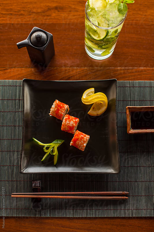 Sushi Served on a Black Plate by Mosuno for Stocksy United