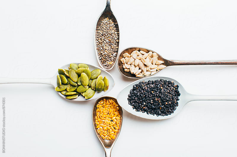 Different seeds in spoons. by BONNINSTUDIO for Stocksy United