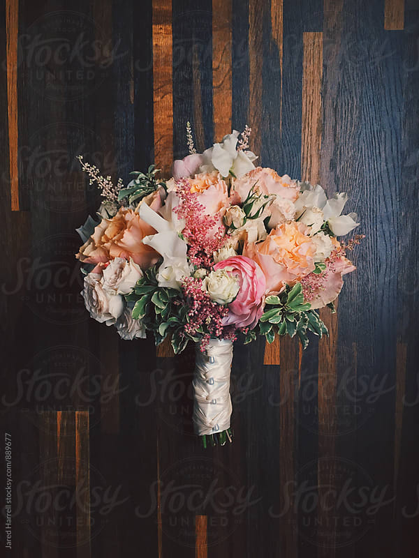 Floral Bouquet on Wooden Floor  by Jared Harrell for Stocksy United