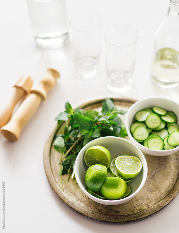 Cucumber-mint mojito ingredients by Pixel Stories for Stocksy United