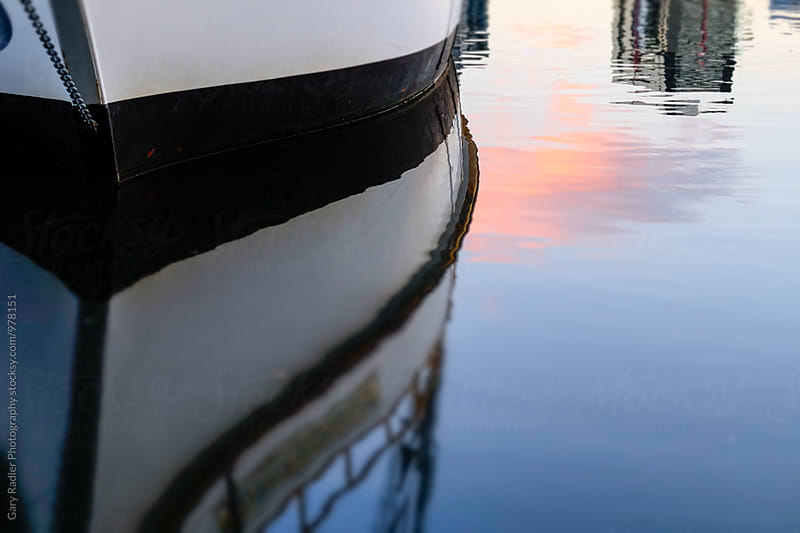 Reflection of a Moored Black and White Boat