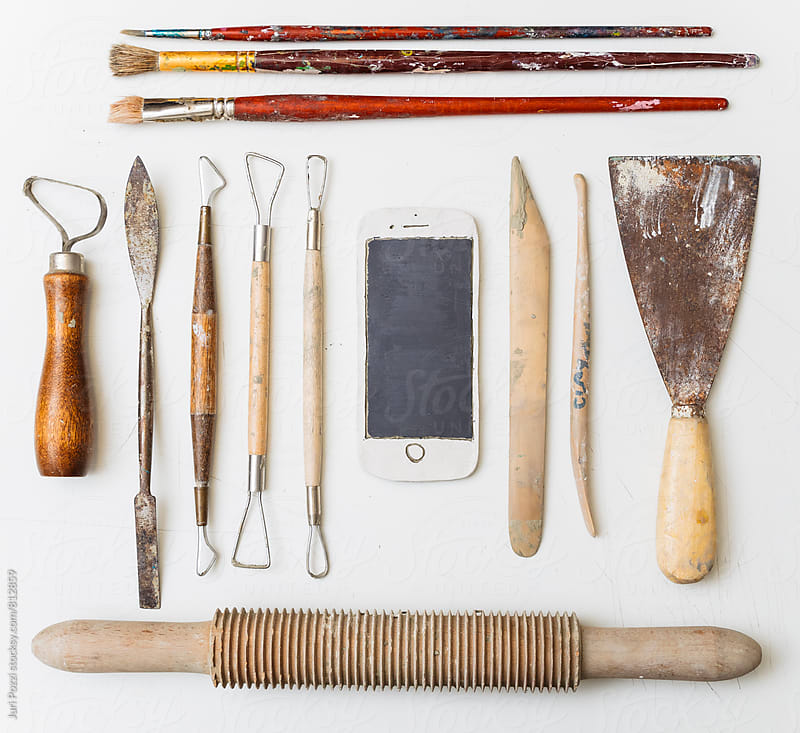Smartphone made of clay with tools by Juri Pozzi for Stocksy United