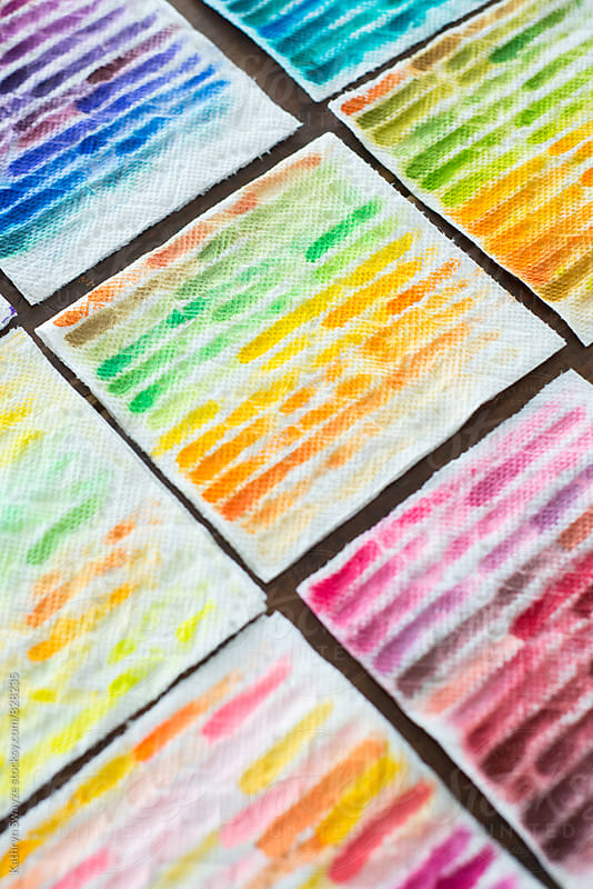 Colorful paper towel rags, used to clean off a paintbrush by Kathryn Swayze for Stocksy United