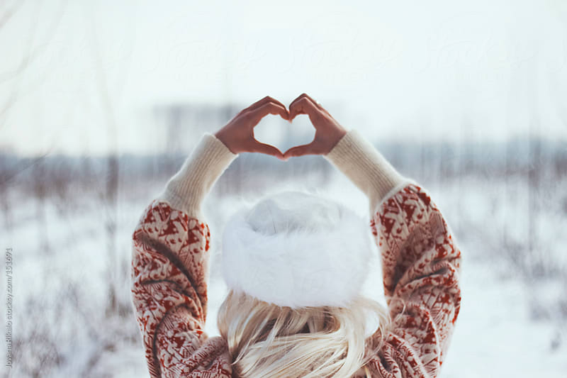 Girl making heart shape with hands by Jovana Rikalo for Stocksy United