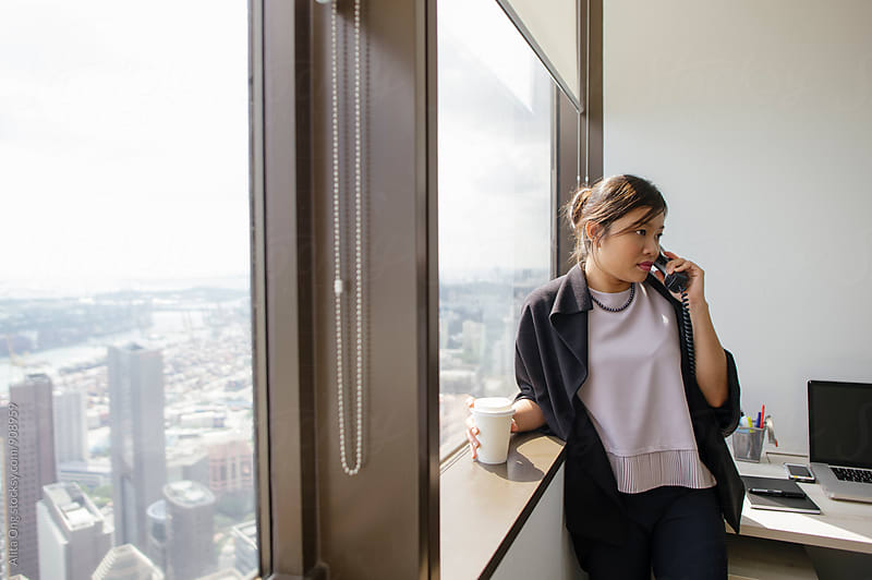 Businesswoman on the phone  by Alita Ong for Stocksy United