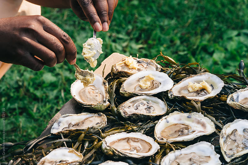 Preparing raw oysters with miso butter by Jen Grantham for Stocksy United