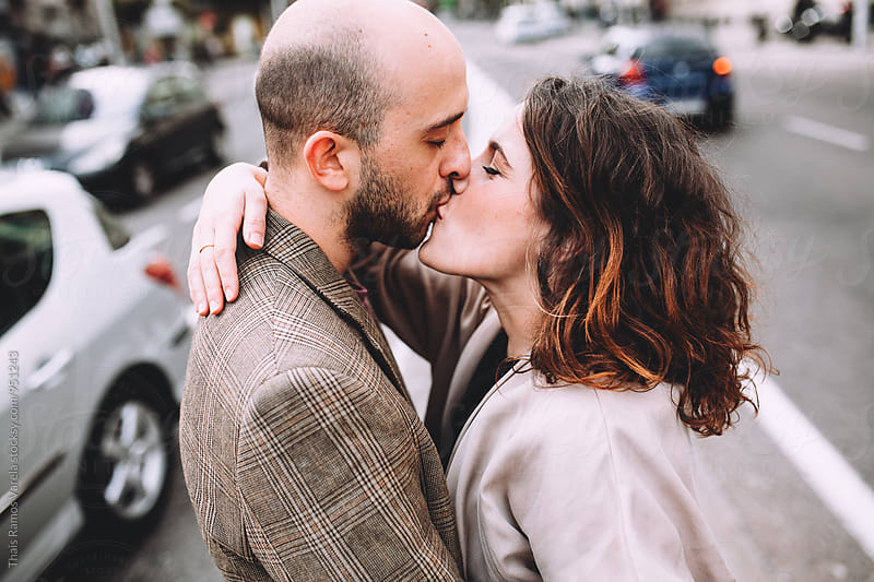 kissing couple by Thais Ramos Varela for Stocksy United