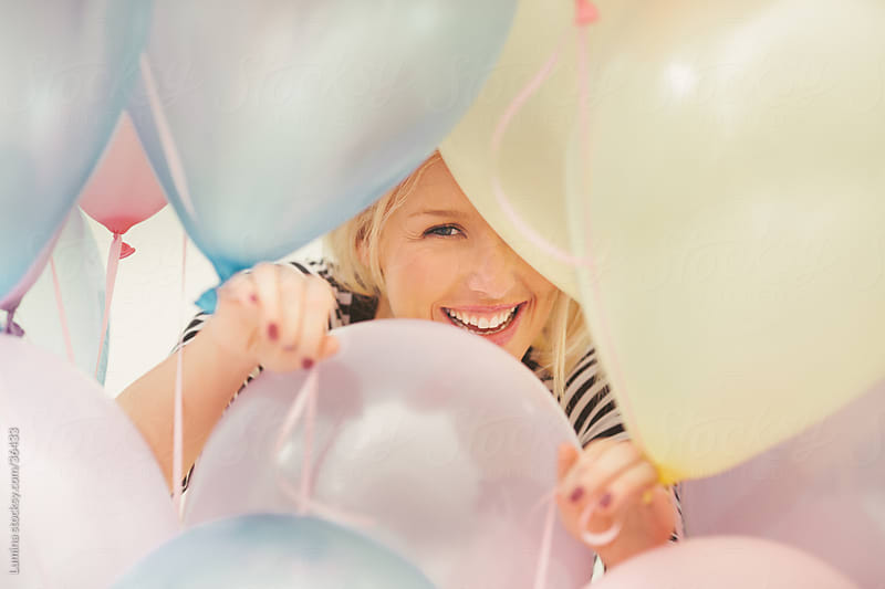 Woman and Balloons by Lumina for Stocksy United