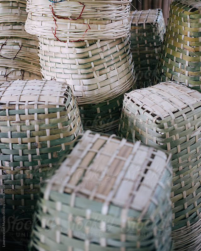 Stacks of empty baskets in a farm ready for the fruit harvest  by Lawrence del Mundo for Stocksy United