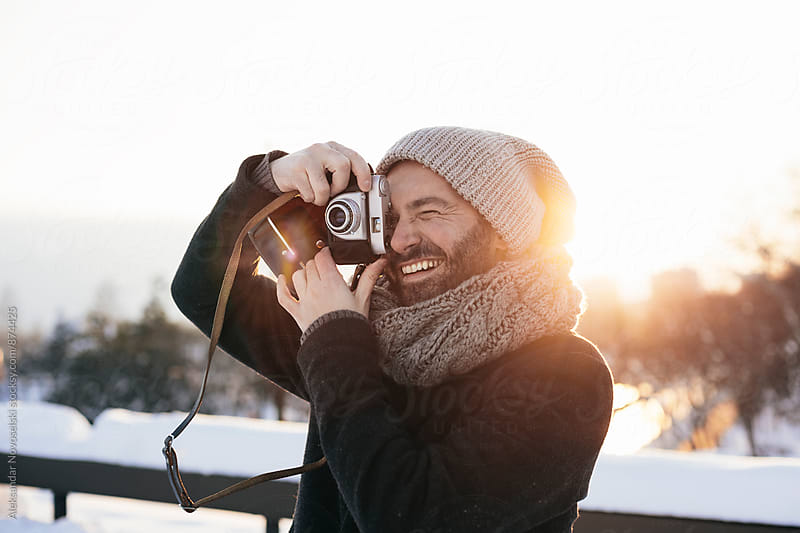 Stylish bearded man with film camera by Aleksandar Novoselski for Stocksy United