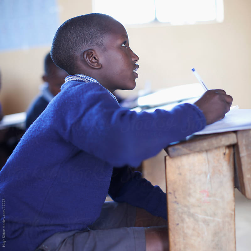 School children in busy classroom. Kenya Africa. by Hugh Sitton for Stocksy United