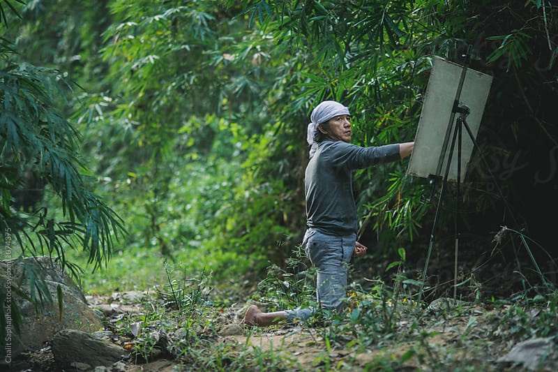 Working in the wild by Chalit Saphaphak for Stocksy United
