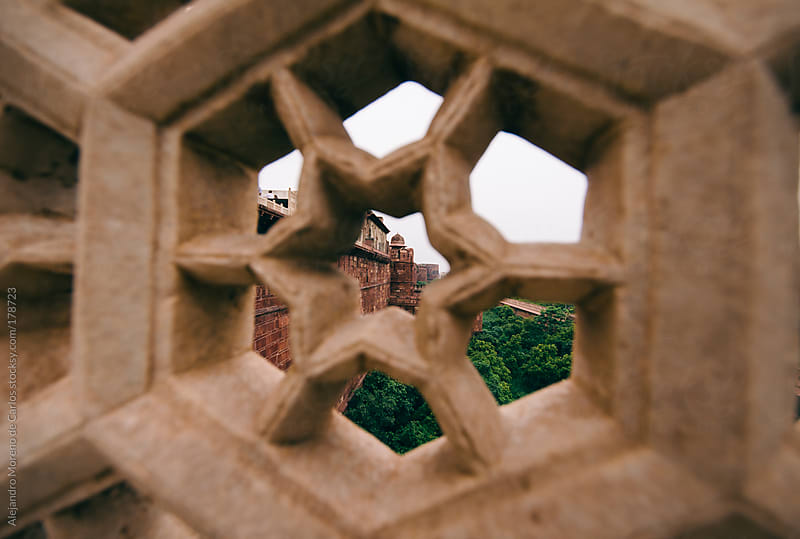 Agra fort tower seen through a star of marble, Agra, India. by Alejandro Moreno de Carlos for Stocksy United