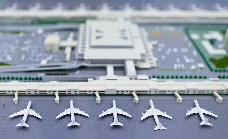 Aircraft models parking at miniature airport by Lawren Lu for Stocksy United