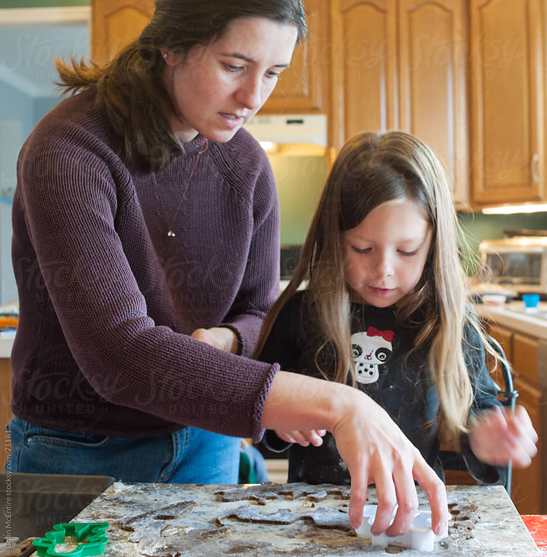 Family Baking: Mother and Daughter Bake Gingerbread cookies by Brian McEntire for Stocksy United