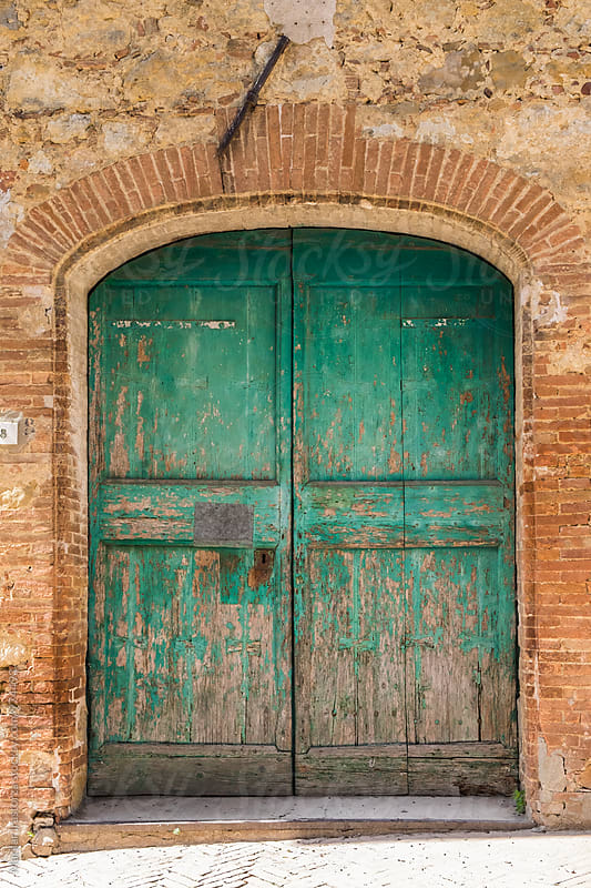 Old green rustic door by Marilar Irastorza for Stocksy United