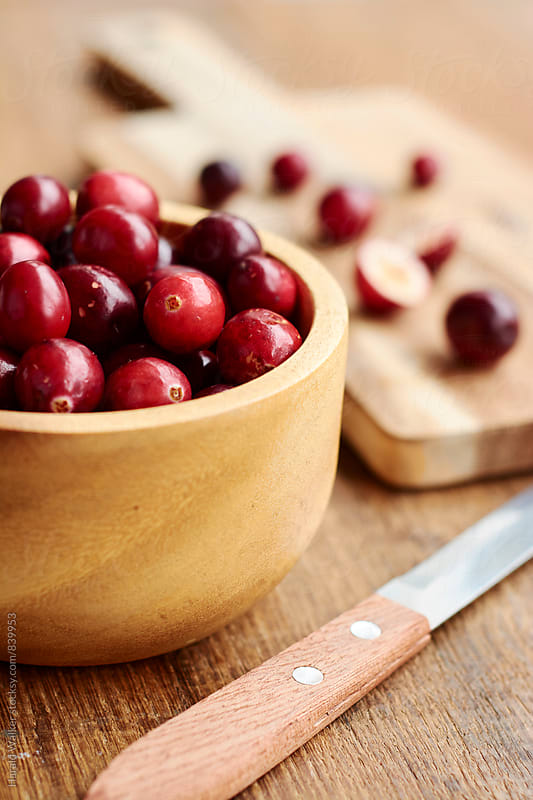 Preparing cranberries by Harald Walker for Stocksy United