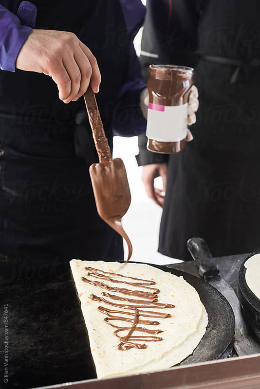 nutella crepe at an outdoors food stall by Gillian Vann for Stocksy United
