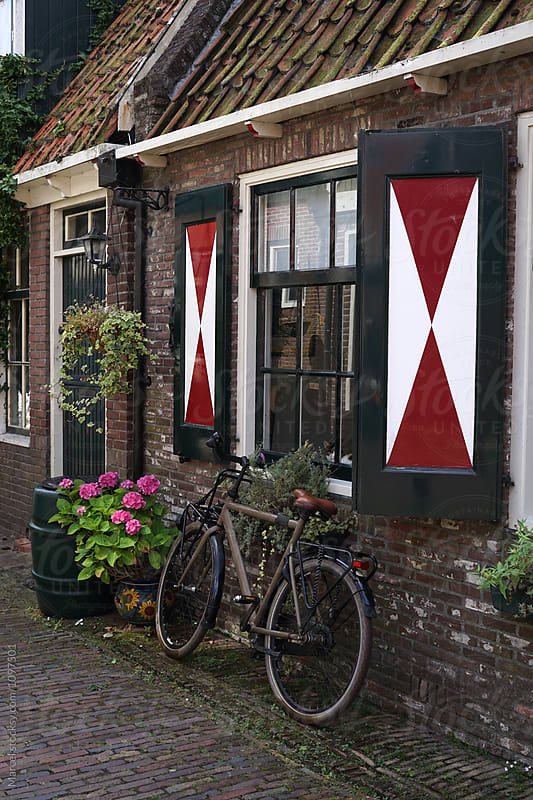Old Dutch street with bike by Marcel for Stocksy United