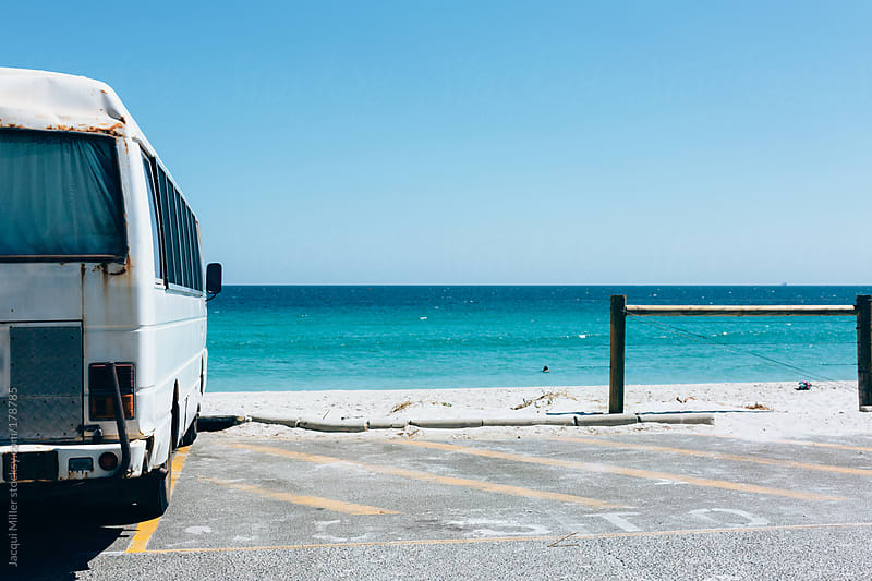 Rusted old mini van parked at the beach. by Jacqui Miller for Stocksy United