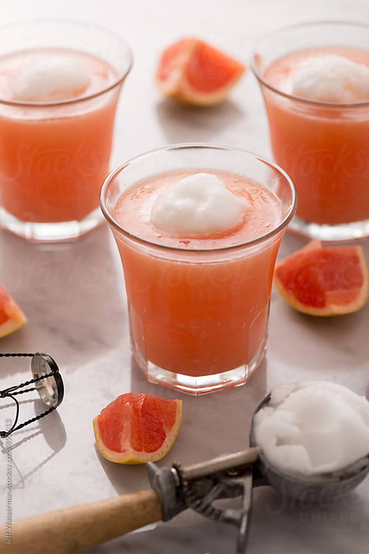 Champagne and Grapefruit Cocktail by Jeff Wasserman for Stocksy United