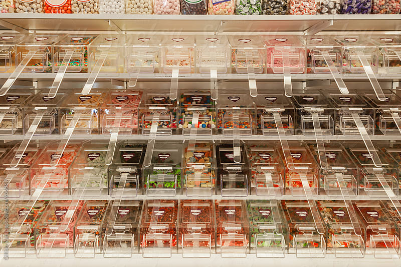 lolly bays in a shop by Gillian Vann for Stocksy United