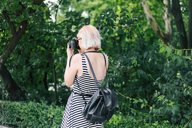 Woman photographing, from the back by Marija Kovac for Stocksy United